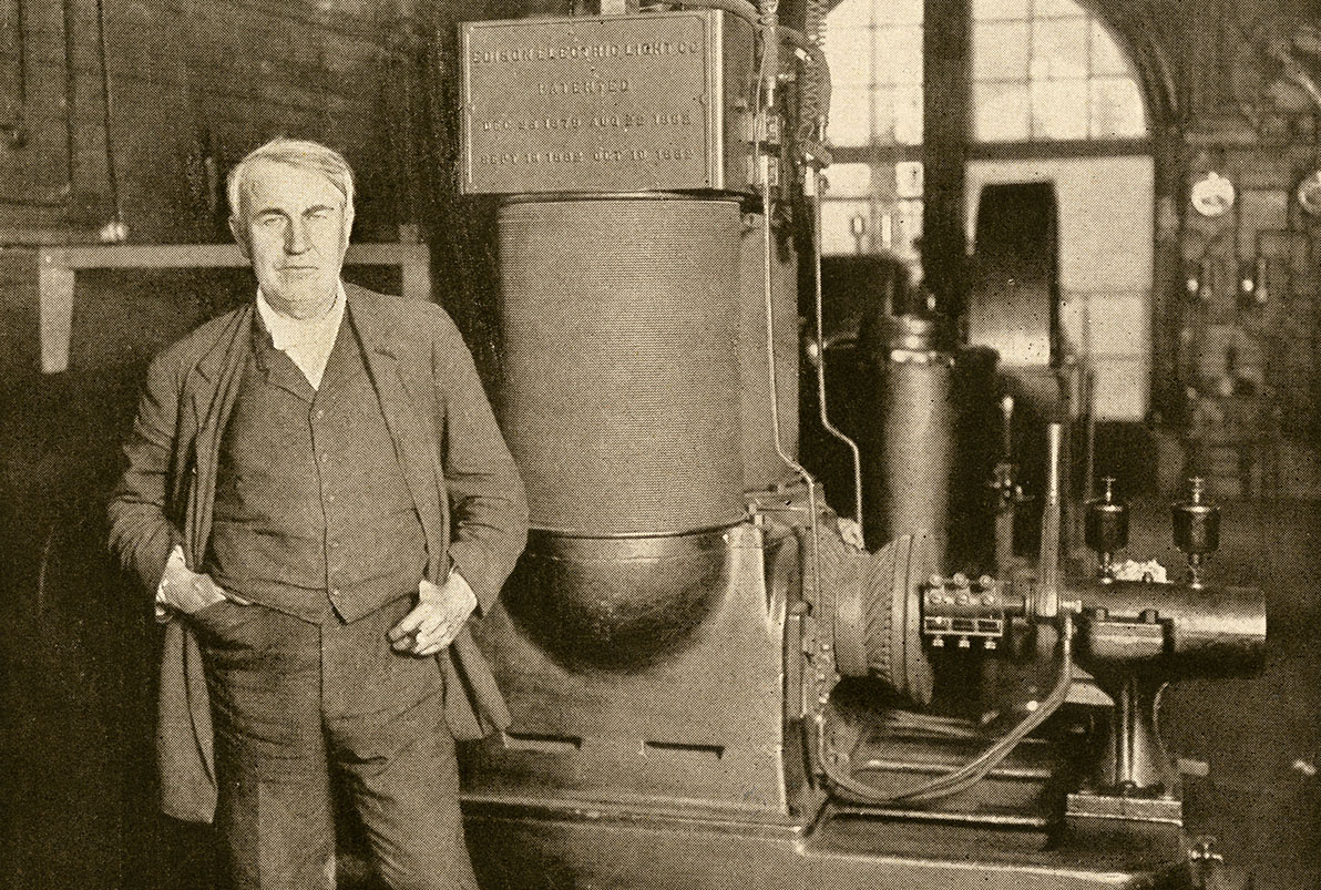 Thomas Edison with his dynamo that generated the first commercial electric light New York City