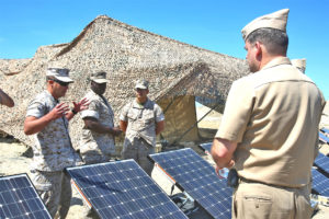 Marines with 7th Engineer Support Battalion, 1st Marine Logistics Group, explain the portable solar plant.