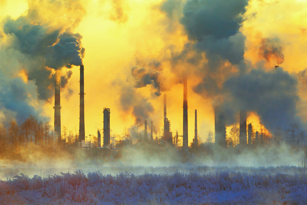 smoke and pollution come from stacks including coal power plants