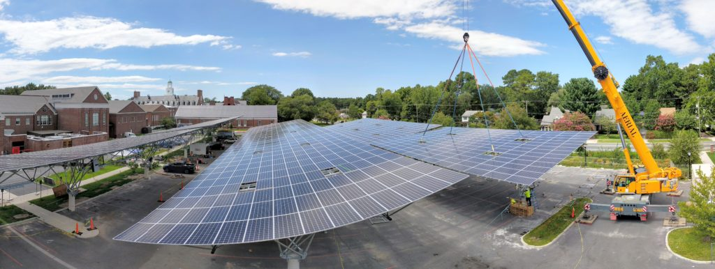 a large scale photo of a quest renewables installation - solar panels over a parking lot